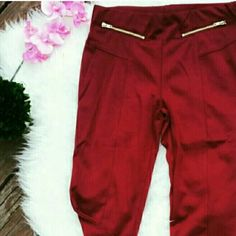 Burgundy / wine color versatile skinny pants Rich Burgundy color skinny pants with seam detail in the middle (vertical) and zippers Elastic waistband  Polyester, rayon, and spandex *Can be dressed up to a night out or business casual for the office Pants Skinny