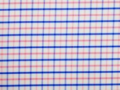 Tatersall is a check pattern that consists of thin, regularly spaced stripes in alternating colors that are repeated both horizontally and vertically. The stripes that create the tatersall pattern often come in two different colors and are usually darker than the background color.