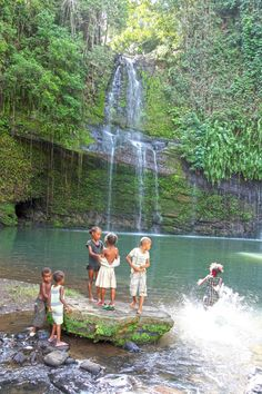The bath - A group of Malagasy children in Nosy Be, Madagascar.