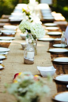 easy wedding table decor ideas #burlap #masonjars http://www.weddingchicks.com/2014/01/06/weekend-wedding/