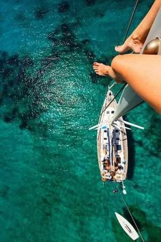 Girl on the pole of a sailboat heights