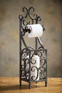 An ideal paper towel or tissue dispenser. Wrought Iron www.MadamPaloozaEmporium.com www.facebook.com/MadamPalooza