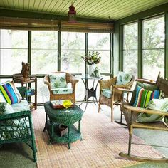 ❤ Pick a palette- A bold color on a couple of pieces of furniture adds impact and contrasts with the earthy elements on this screen porch.
