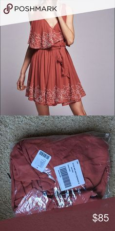 NWT Free People Sylvia Mini Red Rouge Medium Absolutely gorgeous Free People dress. Heavy and romantic. Beading is gorgeous and the color is timeless. I have two available in size medium. Both brand new with tags in boutique bags. Sizes vary so I would say it can really fit anyone from XS to M depending on desired fit. Probably best for small and mediums though! Free People Dresses Mini