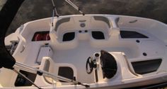 Bayliner Element: The Element offers storage under every seat in addition to an anchor locker at the bow. Notice the removable fuel tank under the port quarter storage.