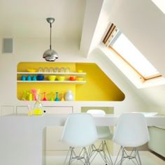 Love this bright pop of yellow in a predominantly white kitchen