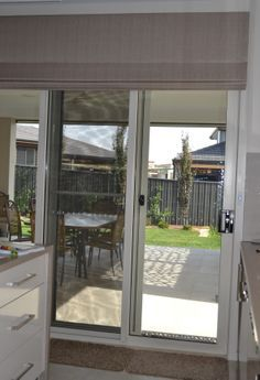 Solar roller shade on a sliding door sliders and patio door ideas roman blinds are great for sliding doors planetlyrics Choice Image