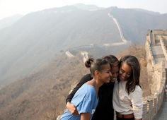 A great moment captured by Amanda Lucidon of the First Lady and daughters Sasha and Malia during their visit to the Great Wall of China on March 23, 2014.