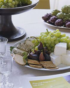 Ina Garten's cheese plate: grapes, figs, crackers, and cheese. So basic, so Ina!