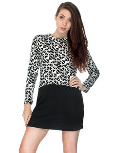 This retro inspired mini dress is designed with an all over geometric print and a high collar. Its long sleeve style adds a touch of sophistication in a sleek and comfortable fit. Material: Cotton Ble
