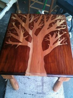 How To: Stencil with Stain (via Curbly | DIY Design Community) Not so much digging this as a table, but as wall art it would be amazing!