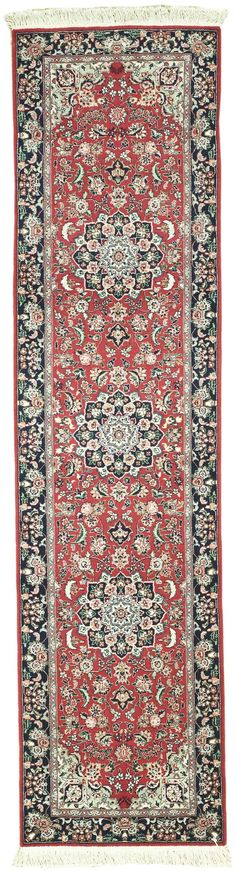 Handmade and knotted rectangular Persian Tabriz runner area rug with leaf and floral designs in red with blue accents, 2x9. Made with wool. Free Shipping within the US.