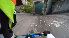 Daredevil Primož Ravnik rode his bicycle down the nearly vertical wall of a Slovenian dam and captured the nearly 200 feet plunge on his GoPro camera. The stunt was part of a contest by GoPro … Gopro, Cycling Memes, Bike Magazine, Happy Memes, Downhill Bike, Video Contest, Extreme Sports, Mountain Biking, Mountain Climbing