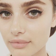 Modern 60s doe eyed fresh face + natural but full brows + peach nude mouth