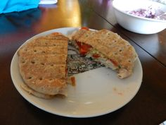 Sandwich flat with turkey, mozzarella, and tomatoes grilled on a Foreman