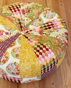 What a great pouf...or possibly a footstool w a base! Stash