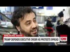 Trump defends travel ban as protests spread