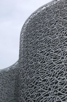 The impressive metal screen of China's Suzhou Science and Cultural Arts Centre façade designed by Studio505, an intricate hexagonal matrix.