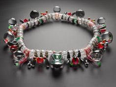 Necklace consisting of one hundred and eight articulated laminated and carved acrylic components strung on wire: English, Cumbria, by Adam Paxon, 2006