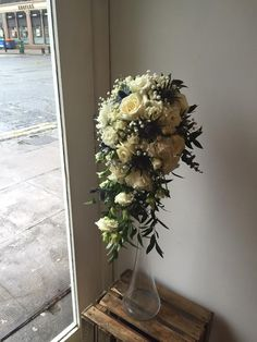 Avalanche rose, thistle and gypsophila shower bouquet