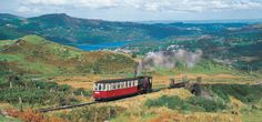 The Snowdon Mountain Railway, the UK's only rack and pinion railway, which climbs towards the summit of Snowdon, the highest mountain in Wales. The journey is included on our Railways & Castles of Wales tour. https://www.greatrail.com/trains/snowdon-mountain-railway/
