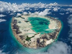 The Seychelles' Saint Joseph Island, once a coconut plantation, is now a nature reserve with a marin. - Photograph by Thomas P. Mobiles, Seychelles Islands, Ocean Day, Oceans Of The World, Sea Birds, Nature Reserve, Aerial Photography, National Geographic, National Parks
