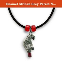 """Enamel African Grey Parrot Necklace by The Magic Zoo. Perfect for an African Grey lover, my enamel Grey parrot necklace has been handpainted with beautiful translucent red on the tail, and lovely black accents on the beak and the feet. The parrot itself is 7/8"""" tall and 3/8"""" wide. Necklaces come on an 18"""" black rubber cord with a lobster claw fastening. Glass beads are added to enhance the design. All of my """"cold enameled"""" jewelry is painted by hand with a durable epoxy paint, and are…"""