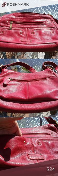 """Red Leather Bag by Stone and Co Really lovely all leather bag, well made by Stone and Co, with pretty blue lining. One wide zipped pocket and two smaller snap pockets in front. Wide zipped pocket on back. Inner compartment has three open pockets and one inner zipped pocket. Measures approximately 11"""" wide by 8"""" high and 3"""" deep. Only used a few times.. In excellent condition. Comes from nonsmoking home and I ship quickly. Stone and Co  Bags Shoulder Bags"""