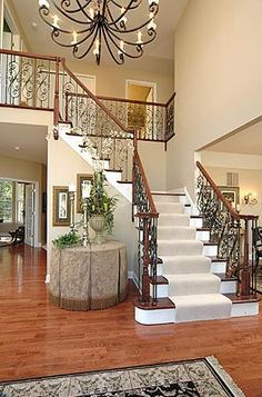 pictures of foyers | The Waterford's dramatic two story foyer and landing staircase with ...