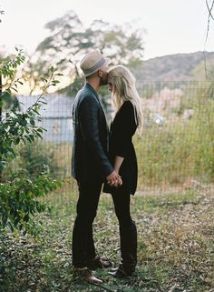 love the dark colors to make the couple really stand out and the guy with a hat!