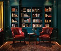The mustard, linen drapes and red wing chairs play off the exuberant, turquoise millwork. The rich and bold hues create an enchanting library. By Casey Design/Planning Group Inc. www.caseydesignplan.com  Photography by Ted Yarwood