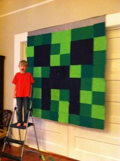 Minecraft Creeper for 7yo birthday party.  Felt squares glued to a shower curtain with spray adhesive.  Simple but makes an impact!