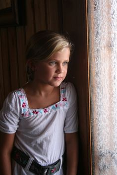 young girl in window