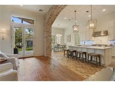 old oak floors, old chicago brick floors and arch. Except I would keep the wood flooring through out. Love the brick archway. Reclaimed Hardwood Flooring, Brick Flooring, Kitchen Flooring, Brick Floor Kitchen, Flooring Ideas, Brick Pavers, Exposed Brick Kitchen, Penny Flooring, Hardwood Floors