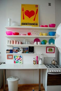 Squeezing everything into a small kitchen can be tough, but it doesn't mean you have to sacrifice appeal. Minimization, organization, and creative use of space are the key. And if you can - throw in some colour. Why not?