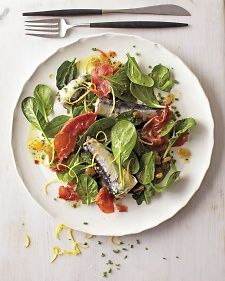 Sardines go sophisticated, and add enough heft to call this bright and balanced salad a full meal. Lightly baked strips of prosciutto play beautifully off of tart lemon zest and sweet golden raisins.