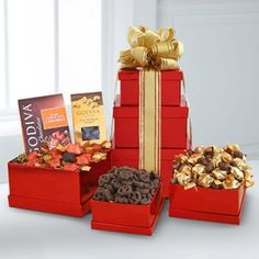 This festive red Godiva® Tower is a perfect way to wish Happy Holidays to friends, family and business associates this season. Each of these three red shiny boxes is filled with sweet surprises including Godiva® dark chocolate caramels, Godiva® milk chocolate cashews and Godiva® chocolate covered pretzels. Decadent and well deserved!