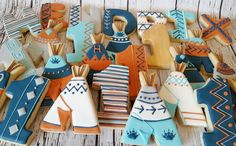 Aztec decorated sugar cookies with teepees and number 1 for a babies first birthday.  Baked Bliss, Williston ND