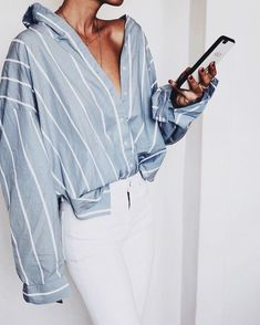 Cute blue and white striped shirt with white jeans.