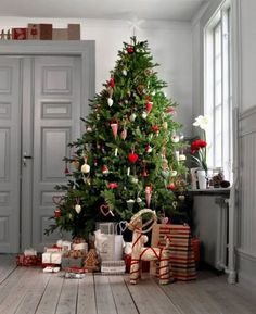 Decorate with a minimal assortment of paper and wooden ornaments and let your tree be the center of attention.