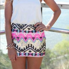 Pink tribal NWT sqort Skirt in front, shorts in back. Has zipper on side. NWT. Fits pant size 0-2 Shorts Skorts