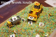 """Sensory box spelling with coloured rice, letters & bulldozers from Totally Tots ("""",)"""