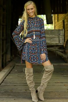 Kayla - I love how she paired this with those over the knee boots.  Retro Love Navy Print Dress at reddressboutique.com