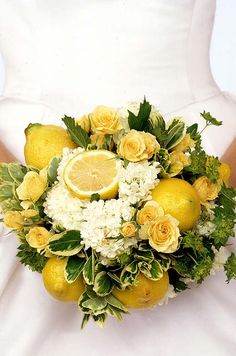 Bright lemons add visual interest, and a fresh scent, to this rustic bridal bouquet. (They're also a surprising touch many may not expect!)