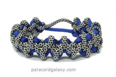 Komodo claw and tooth paracord bracelet with a Mad Max style closure.