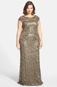 "Free shipping and returns on Tadashi Shoji Sequin Lace Gown (Plus Size) at Nordstrom.com. <p><B STYLE=""COLOR:#990000"">Pre-order this style today! Add to Shopping Bag to view approximate ship date. You'll be charged only when your item ships.</b></p><br>Scrolling lace traced in shimmery metallic sequins brings red-carpet glam to a fitted gown. The illusion yoke puts your face and shoulders in an elegant spotlight."