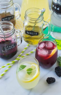 DIY Grown Up Lemonade Cocktail Bar with basil, blackberry, and ginger simple syrup. Guests mix their own drinks. Perfect for summer parties!