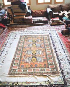 Size: 3.9 x 6.5 Design: Geometric and floral Material: wool, cotton Condition: very good Colors: peach, gold, green, blue, white  Gorgeous rug