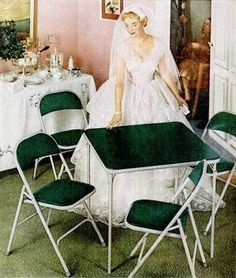 Ah, the new bride and the gift of her dreams...a card table and chairs.  For Real????  samsonite 1954