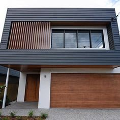 This pristine, modern dream home is made using Scyon Linea. The mixed materials technique gives this home its own unique style and the timber balances out the dark and light paint colours. By @bighouselittlehouse #australianarchitecture #architecture #exterior #exteriordesign #scyonwalls